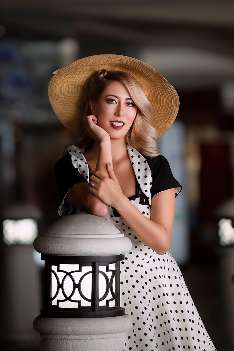 Orange County Portrait Photography, woman in wide brimmed hat posing next to a pillar