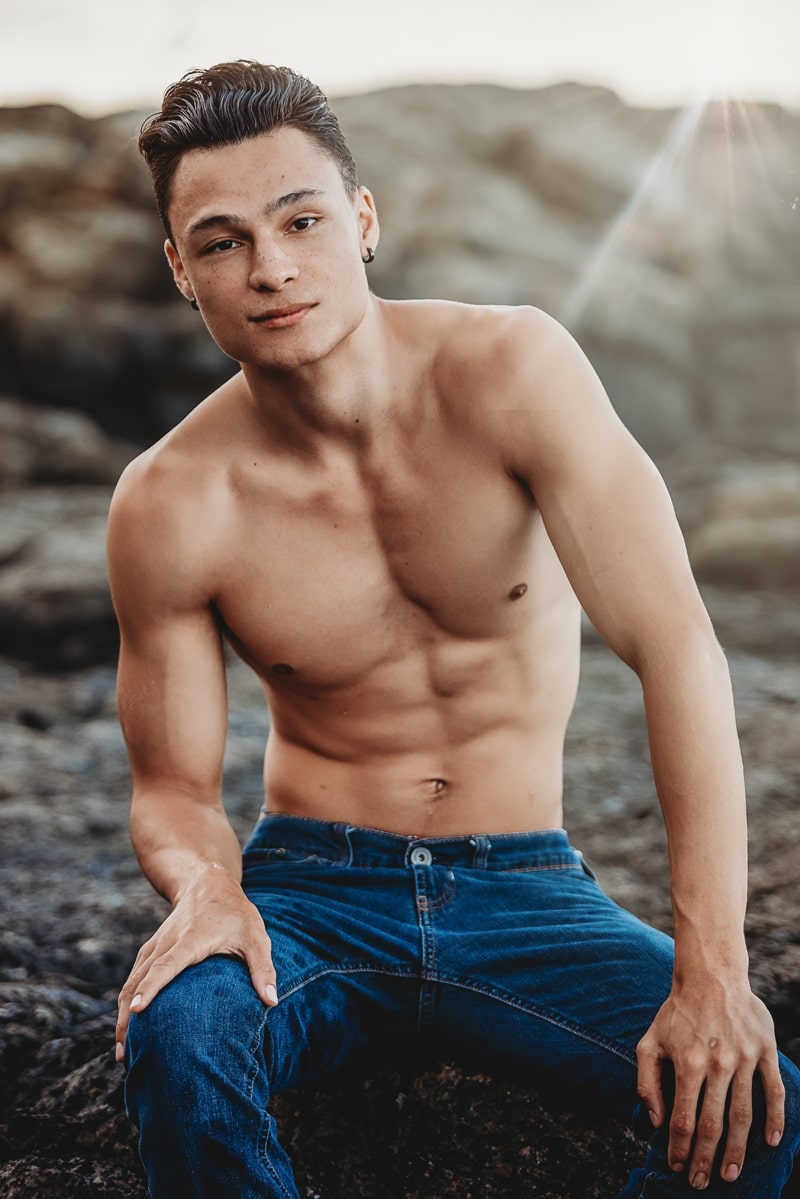 Orange County Portrait Photography, man sitting on a rock at the beach with just jeans on
