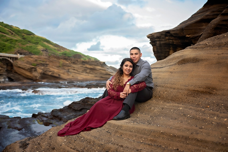 Orange County Couples Photography, couple sitting on an eroded ocean cliff side