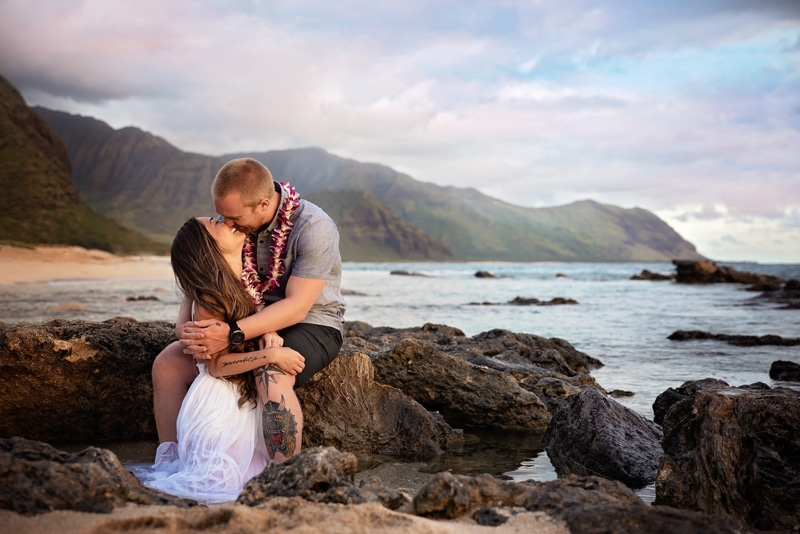 Orange County Couples Photography, couple sitting down and kissing near the water