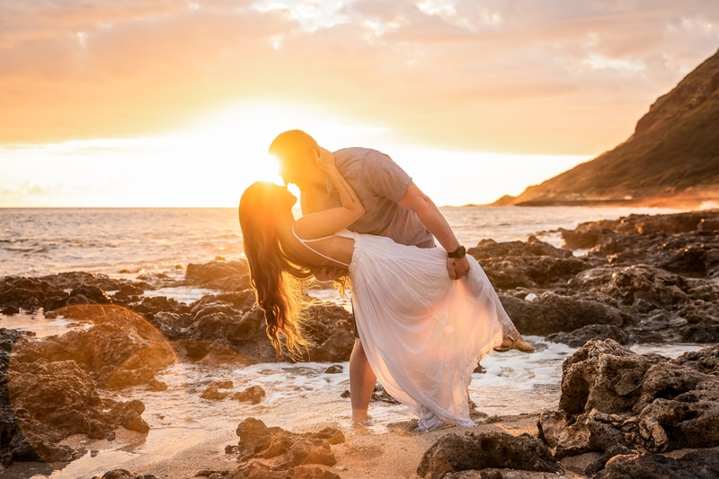 Orange County Couples Photography, man dipping woman with sunset in the background