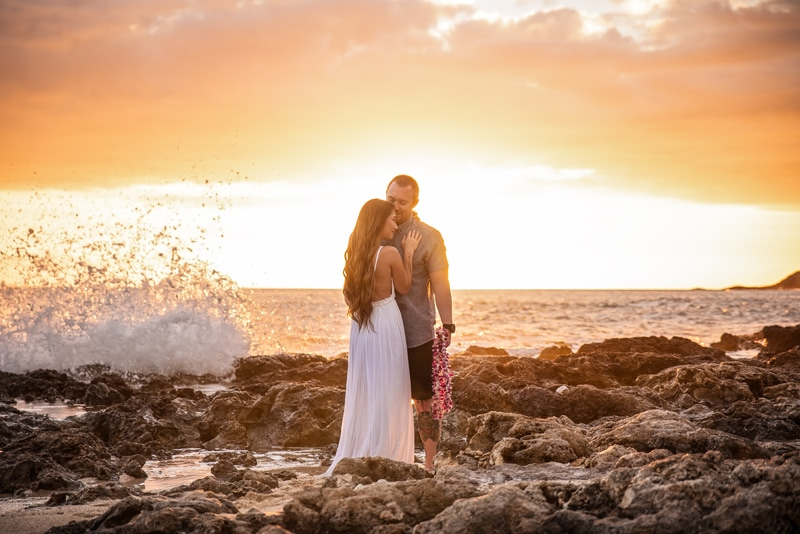 Orange County Couples Photography, man and woman standing on the rocks at sunset