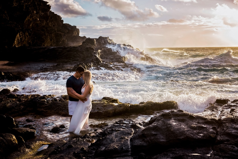Orange County Couples Photography, couple standing at the beach with waves crashing in the background