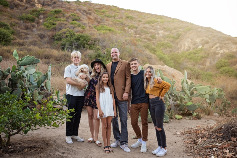Orange County & Los Angeles Family Photographer, family standing together on a dirt path by cactus